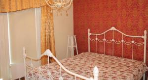 A bed or beds in a room at Kotkapoja Residence