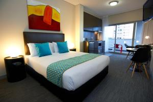 A bed or beds in a room at Quest Bondi Junction