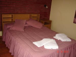 Una cama o camas en una habitación de El Nogal