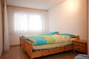 Ein Bett oder Betten in einem Zimmer der Unterkunft Alpbachstrasse 4, Meiringen