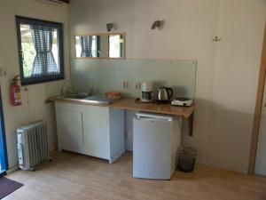 A kitchen or kitchenette at Holiday home OSSA Basecamp