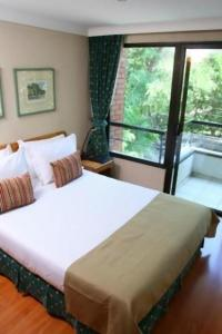 A bed or beds in a room at Presidente Edificio Santiago