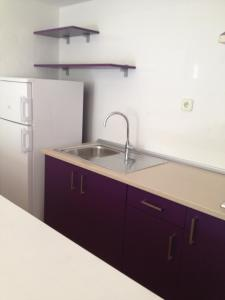 A kitchen or kitchenette at Aparthotel Puerto Cala Vadella