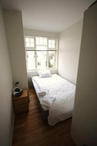 A bed or beds in a room at Norwegian Housing, Solbakkeveien 12