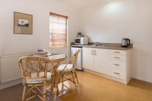 A kitchen or kitchenette at East West Studio Apartments