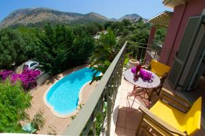 A view of the pool at Stamoulis Villas or nearby
