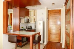 Una cocina o zona de cocina en San Ignacio Suite Apartments