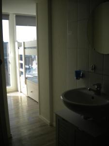 Een badkamer bij Apartment Sandeman