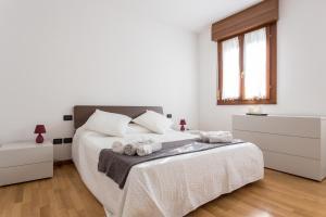 A bed or beds in a room at GuestFriendly 605 - La casa di Maria Rosa