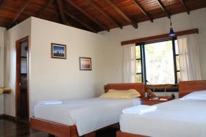 Un ou plusieurs lits dans un hébergement de l'établissement Galapagos Cottages