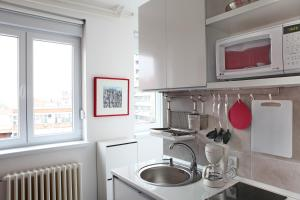 A kitchen or kitchenette at Apartments Petra