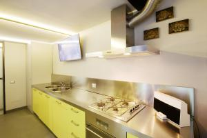 A kitchen or kitchenette at NVK Guest House