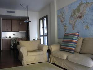 A seating area at Olles Apartment