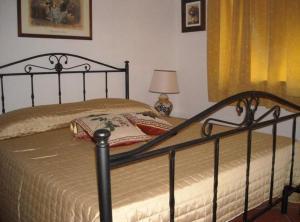 Letto o letti in una camera di Arkos Casa Vacanze