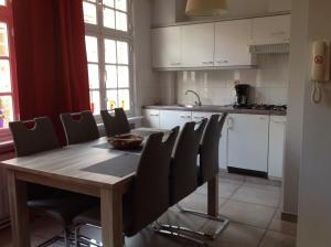 A kitchen or kitchenette at Holiday Home 't Beertje