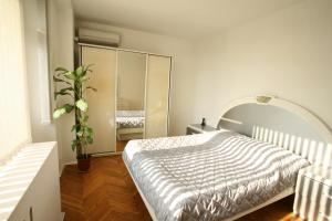 A bed or beds in a room at Serviced Apartments Mayakovskaya