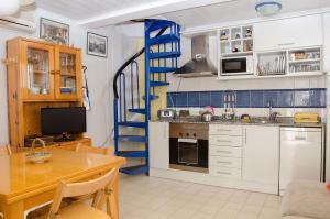 A kitchen or kitchenette at Apartment Oscar