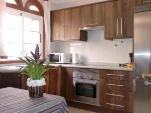O bucătărie sau chicinetă la Casa El Sol