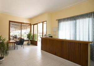The lobby or reception area at Hostal La Perla