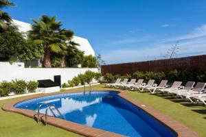 The swimming pool at or near Apartamentos Los Dragos del Norte