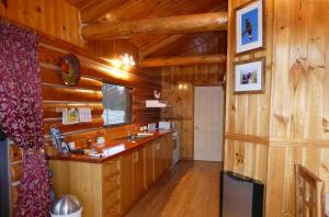 A kitchen or kitchenette at Windermere Cabins