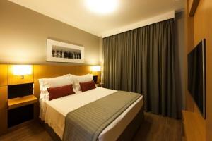 Cama ou camas em um quarto em Olympia Residence