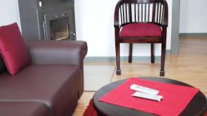 Ein Sitzbereich in der Unterkunft Einhornhaus