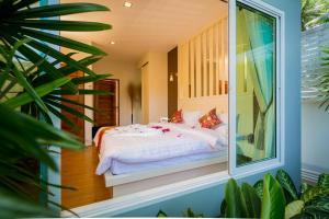 Ein Bett oder Betten in einem Zimmer der Unterkunft Irawan House