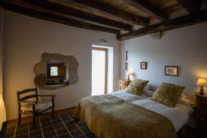 A bed or beds in a room at Azpikoetxea