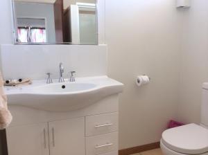 A bathroom at Ocean Breeze Units