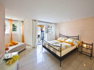 Ein Bett oder Betten in einem Zimmer der Unterkunft Carpe Diem