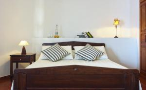A bed or beds in a room at Belvedere Apartments