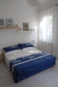 Cama ou camas em um quarto em Da Irene