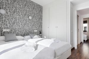 A bed or beds in a room at STAY Bailen