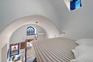 A bed or beds in a room at Domus Solis Luxury Villa