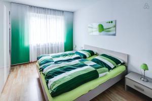 Ein Bett oder Betten in einem Zimmer der Unterkunft Ferienwohnung in Augsburg