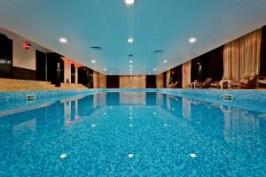 The swimming pool at or near Grand Monastery Hotel Apartments