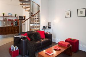 A seating area at TWOFOURTWO Boutique Apartments