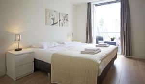 Gulta vai gultas numurā naktsmītnē Stayci Serviced Apartments Grand Place