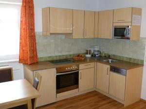 Kuchyň nebo kuchyňský kout v ubytování Das Apartment Binder