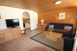 Ein Sitzbereich in der Unterkunft Apartment Neuhaushof