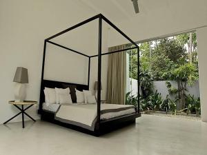 A bed or beds in a room at Pittaniya Villa
