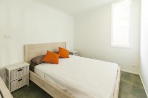 A bed or beds in a room at Drift Beach House Getaway
