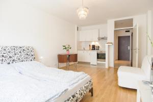 Ein Bett oder Betten in einem Zimmer der Unterkunft Vienna Central Apartments