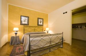A bed or beds in a room at Palazzo Gamba Luxury Apartments