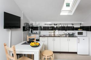 A kitchen or kitchenette at Apartments Heart of Dubrovnik