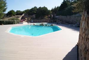 The swimming pool at or near Case Della Marina