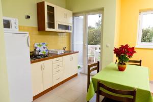 Cuisine ou kitchenette dans l'établissement Vila Amantina