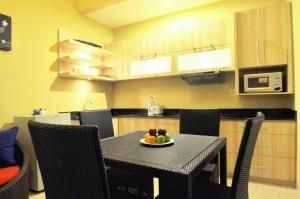 A kitchen or kitchenette at The Jas Villas