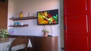 TV o dispositivi per l'intrattenimento presso Apartments Rho Fiera